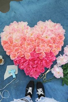 So pretty! Hanging Flower Heart DIY (click through for tutorial). This could be scaled up to whatever size you like, just by gluing pieces together. What a fab photo backdrop!