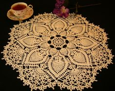Crocheted doily, from one of my many Japanese doily pattern books.