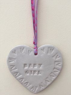 A personal favourite from my Etsy shop https://www.etsy.com/uk/listing/272450354/loveheart-hanger-gift-idea-pottery-one