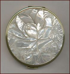 Vintage compact with carved mother of pearl top something like this but a little different and bigger maybe heirloom piece