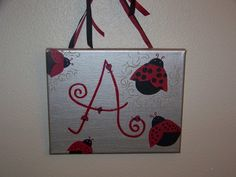 Personalized Letter w/ Lady Bugs Nursery Children Baby Girl Art Choose Your Colors & Size. $17.00, via Etsy.