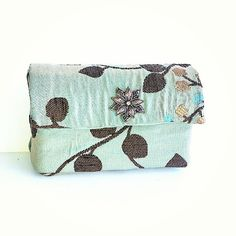 """Mint Mocha Macaroon"" clutch measures approximately 4""x 6"". Plenty of room for a Samsung Galaxy phone and other trinkets.  Perfect for a lazy Sunday afternoon stroll."