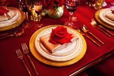 Gold Place Setting with Rose | Photography: Jenna Henderson for White Rabbit Photo Boutique. Read More: http://www.insideweddings.com/weddings/dramatic-red-shoot-inspired-by-disneys-beauty-and-the-beast/752/