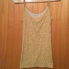 Ann Taylor LOFT Gold and white tank top Soft gold and white tank top. 94% Rayon. 6% Spandex. LOFT Tops Tank Tops