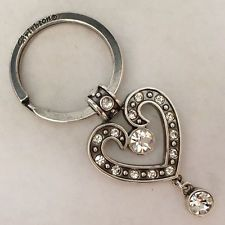 Silver tone key ring and chain in shape of heart with white rhinestone... Lot 61