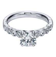 White Gold Diamond Engagement Ring with round bezel set side stones. Available at Becker Jewelers!
