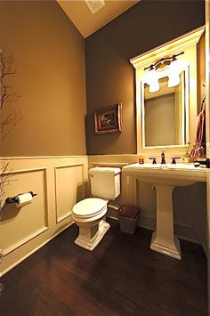 Wainscoting in the powder room.  Forget real wainscotting....paint two colors, add chair rail and extra pieces of wood made into a square.  DONE.