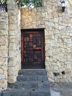 Beautiful wooden door and stone wall