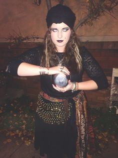 My Fortune Teller Halloween Costume. Crimped hair, white contacts, dark makeup, turban, black shirt, LOTS of random fabric on a belt, tights, boots, and LOTS AND LOTS of jewelry! Best costume I've had yet!