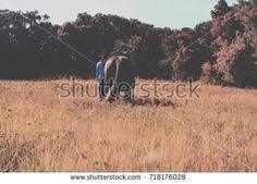 Cowgirl walking west