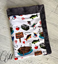 ***Options*** Please read carefully!! Fishing with charcoal hide backing. Minky blankets are minky on both sides. 2 week turnaround time. Lovey Blanket- This size pictured Measures approximately 18x20 inches. Great for on the go. And perfect for your little one who cant go without their
