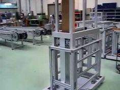 Estructura telescópica en perfiles y accesorios MiniTec accionada por columna eléctrica para máquinas de impresión laser.