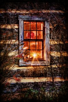 Looking through night windows of a log cabin....