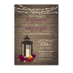 Lantern Wedding Invitations Rustic Fall Plum Florals. Set on a barn wood background, this rustic autumn wedding invitation boasts a metal lantern with florals in wine, berry, orange , red, plum and burgundy. Additionally, we have added flickering string lights across the top of fall wedding invitations. Beautiful script calligraphy completes the design.