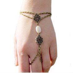 Boho slave bracelet As pictured. New in original packaging . Jewelry Bracelets