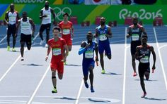 China's Peimeng Zhang, left, United States' Jarrion Lawson, center, and Canada's Mobolade Ajomale compete in a men's 4x100-meter relay heat during the athletics competitions of the 2016 Summer Olympics at the Olympic stadium in Rio de Janeiro, Brazil, Thursday, Aug. 18, 2016. (AP Photo/Martin Meissner)
