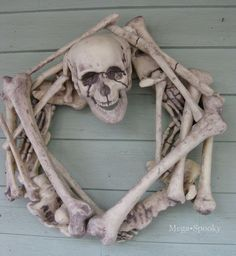 Wreath made from styrofoam Dollar Store skeleton. This would be a fun craft for Halloween.