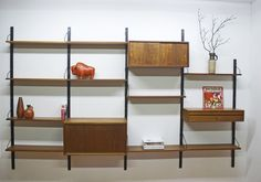 Teak shelving system by Poul Cadovius