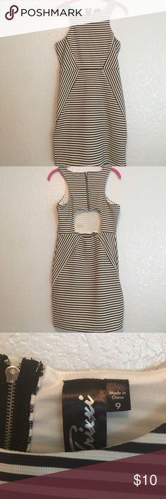 Black and White Cutout Back Dress Short black and white dress with a cutout back, gently used, has a makeup stain on the inside of the dress from taking it off Trixxi Dresses Mini