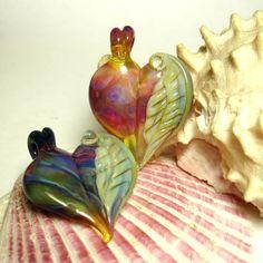 Winged Heart Pendant Pair  Boro  by Samma by sammaparcels on Etsy, $75.00