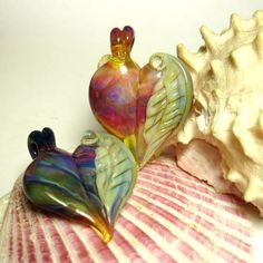 Winged Heart Pendant Pair  Boro  by Samma by sammaparcels on Etsy, $75.00
