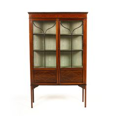 Circa 1910, English inlaid mahogany china cabinet. Clean, classic lines on this beauty. Its smaller dimensions make it perfect for many different locations in the home. To see our otherKeep reading…
