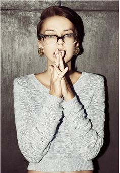 hair up, glasses, big earrings & comfy long-sleeved top/sweater. pair with skinny jeans or ankle pants, thin belt & flats