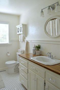 DIY Farmhouse bathroom with white vanity and Ikea wood countertop, beadboard, trim and tile floors. White Vanity Bathroom, Wood Bathroom, Bathroom Ideas, Basement Bathroom, Bathroom With Beadboard, Downstairs Bathroom, Bathroom Vanities, Bathroom Interior, Master Bathroom