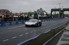 Bavaria City Racing came to Dublin on the of June 2012 and here are some of the photos from a rainy day in the Irish capital. Jenson Button racing down the north quays in Dublin in his McClaren Supercar City Racing, Mclaren Mp4, Formula One, Bavaria, Supercar, Dublin, Button, Buttons, Knot