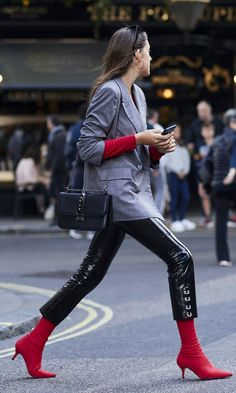 New York Street Fashion Week street style: black pants, red sock boots, plaid jacket, black cross-body bag