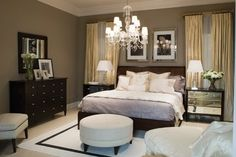 Master bedroom: brown walls, gold curtains, white bedding, and black furniture. Elegant and somewhat masculine