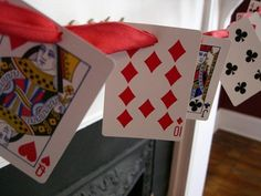 Décor: Playing Card Garland. Can also print these on sheets of paper to make it on a larger scale.