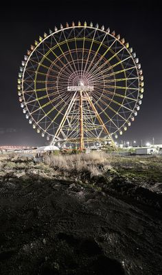 Backlit by the powerful lights of a golf course, this enormous ferris wheel sits abandoned near the beautiful Biwa lake, Shiga Prefecture. It is the sole remainder of Family Land, a Japanese theme park that closed in 1970.