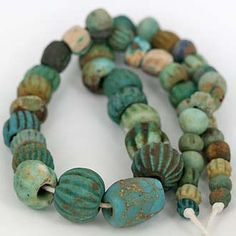 Gorgeous collection of very old faience beads with worn robust condition. Size & color remain outstanding. Central bead measures 23 x 18mm