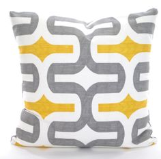 A smart and contemporary new fabric called Embrace in corn yellow and storm gray on a white background. You choose the quantity and size from the drop down list.  Pillow cover has an envelope back closure in the same fabric as the front. All seams are serged to prevent fraying.  The pillow insert is not included but can be purchased at any craft, fabric, or discount store.  THE FINISHED SIZE OF THE PILLOW COVERS WILL BE APPROX. 1/2 SMALLER THAN THE INSERT FOR A SNUG FIT.  To see all the...