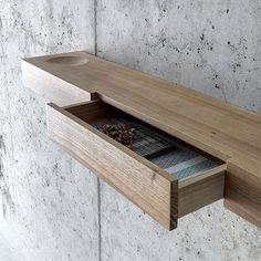 Details... . Bàuti by @fioronidesign - Shelf in solid walnut provided with drawers and a circular groove as coin tray. In two dimensions. A linear shape versatile and freely adaptable in its placement. #archiproducts #archiproductsshop #design