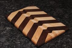 Arrow Pattern cutting board using walnut and maple wood.