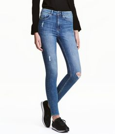 Denim blue. 5-pocket, ankle-length jeans in stretch denim with heavily distressed details, ultra-slim legs, and a high waist.