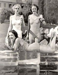 Marie Wilson, Carol Hughes and Ann Nagel keeping cool on a hot day. USA. 1930s.  Like