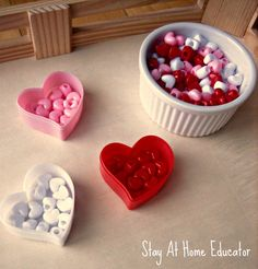 Sorting buttons in montessori inspired Valentine's themed preschool tray - Stay At Home Educator