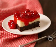 Decadent Brownie Dessert Recipe │ A rich brownie, cheesecake type of dessert smothered in sweet cherries.
