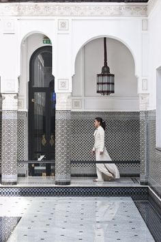 Reception hostess on the black and white tales courtyard at Hotel La Mamounia in Marrakech
