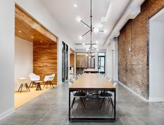Brush Factory designed and built these long communal tables with under mount electrical outlets for anyone to plug in at any time.    This is the entrance to Union Hall: a renovation project in Over the Rhine Cincinnati that is now home to Cintifuse, CincyUpTech and the Brandery.