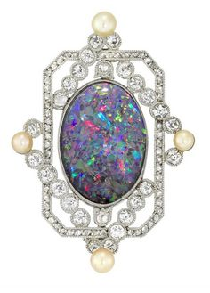 AN OPAL AND DIAMOND BROOCH  An opal and diamond brooch, the oval cabochon-cut black opal, measuring approximately 18.2 x 12.6mm, circa 1920.
