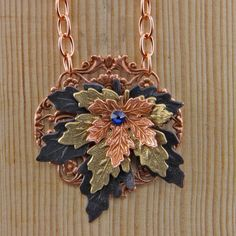 Mixed metal challenge Maple leaves riveted to a fine filigree