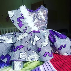 Sleeveless ankara dress with a sach along one side of the upper body. nicely combined with silver sequin. fully lined with satin hemed with crinoline Cute Girl Dresses, Unique Dresses, Little Girl Dresses, New Dress For Girl, Dress Girl, Kids Outfits Girls, Girl Outfits, Ankara Styles For Kids, Ankara Dress