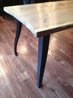 Table by Clawhammer Co. with hand-forged legs by Phoenix Handcraft