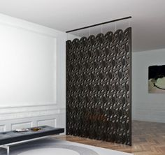Ta'a Room Divider  A contemporary take on the traditional Arabic 'msharabiya', based on Diwani calligraphy. This specific room divider features the letter 'Taa', yet you may request a customized piece with any letter or name of your choice! www.kashidadesign.com