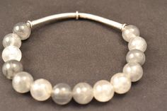 Gray agate beads with a silver bar.