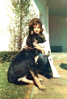 Oh... Here's Jacqueline with her truly beloved German Shepherd 'Clipper'... A gift to her from Joe Sr.. Clipper slept at the foot of Jackie's bed... <3 !